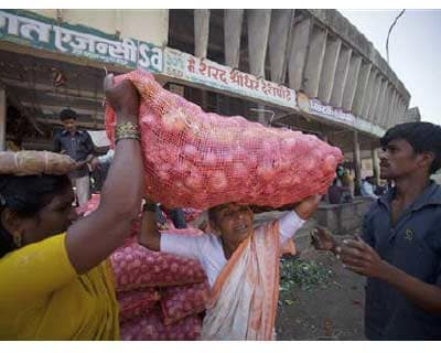 <p>A labourer (C) carries a 50kg sack of onions on her head as she moves it to a delivery truck at a wholesale market in Pune, south of Mumbai</p><p><b>Headline inflation in April is expected to be between 8.5 and 8.6%, the finance ministry&#39;s chi