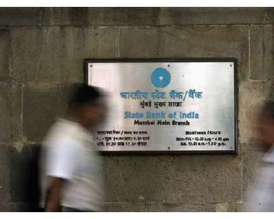 <p>People walk in front of a signboard displayed at the head office of State Bank of India (SBI) in Mumbai</p><p><b>SBI will raise $3-4 bn in offshore debt in the current fiscal year and plans to foray into the domestic bond underwriting business as