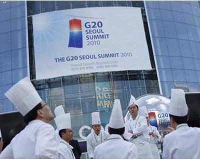 """<p><b>Catering staff pose for pictures outside the Convention and Exhibition (COEX) Centre, venue of the G20 Summit</b> </p><p> After two days of talks, the G20 has ended up at the lowest common denominator. </p><p> An agreement to develop \""""indi"""