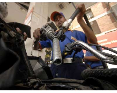 <p>A worker holds a fuel nozzle at a petrol pump in Hyderabad</p><p><b>India&#39;s fuel demand may rise 3.8% in 2012 led by diesel and gasoline, the International Energy Agency said on Wednesday, adding a recent retail price hike by Asia&#39;s third