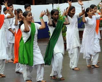 <b>YOUNG BLOOD, YOUNG SPIRIT:</b> Students perform cultural programme during Independence Day celebrations at CST station, Mumbai.