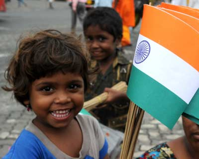 <b>FUTURE OF THE NATION:</b> A street children carries a national flag on the occasion of 65th anniversary of Independence Day.