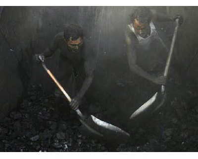<p><b>Labourers unload coal from a truck at a roadside coal store on a highway on the outskirts of Kolkata</b>