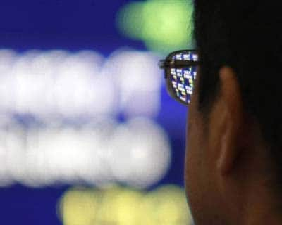 <p>A man looks at a stock quotation board outside a brokerage in Tokyo</p><p><b>The Nikkei stock average fell to a three-month low on Friday as investors moved into safer assets with worries over Greece's debt problems compounding jitters that th