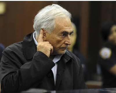 <p>IMF chief Dominique Strauss-Kahn puts his finger to his ear as he stands before judge Melissa Jackson in Manhattan Criminal Court during his arraignment in New York</p><p><b>Dominique Strauss-Kahn faced growing pressure to quit as head of the IMF