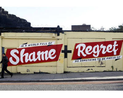 <P> <b>A pedestrian walks past graffiti on a wall, in south Dublin</b> </P><P> Ireland&#39;s central bank chief said on Thursday he expected the country to receive tens of billions of euros in loans from European partners and the IMF to help shore