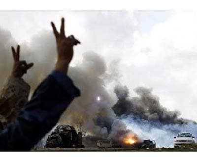 <p><b>Rebel fighters gesture in front of burning vehicles belonging to forces loyal to Libyan leader Muammar Gaddafi after an air strike by coalition forces along a road between Benghazi and Ajdabiyah</b> </p><p> Political unrest plaguing West Asia
