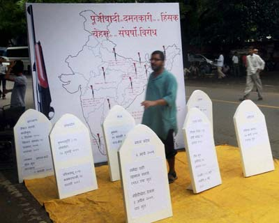 Jan Morcha activists protest against the new Land Acquisition Bill