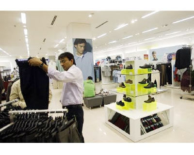 A customer looks at trousers at one of the retail outlets of in Mumbai<p><b>India&#39;s government introduced a wide-ranging tax bill into parliament on Tuesday, but opposition to the move threatened to derail what is one of the ruling coalition&#39;