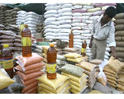 <p><b>A vendor arranges packets of pulses at a wholesale market in Chandigarh</b>