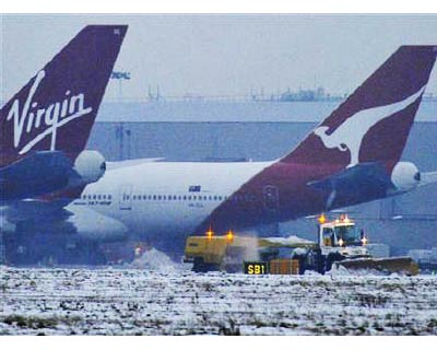 <p><b>Snow is cleared near Qantas and Virgin planes at Heathrow airport in west London</b> </p><p> Airline and international train services were limping back towards normal in parts of Europe on Wednesday, but the lingering effects of ice and snow