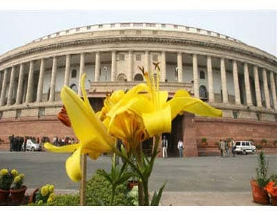 <p><b>A flower blooms in front of the view of the Indian parliament building in New Delhi</b> </p><p> With India's main opposition party continuing to object to bills on tax reform and opening up the $150 billion nuclear power market, several r