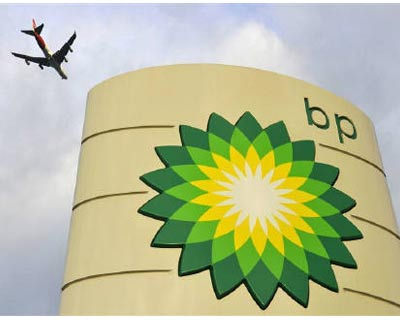<p><b>An airplane flies above a BP fuel station in London</b> </p><p> A $20 billion compensation fund for economic victims of the BP Gulf oil spill opens for business on Monday amid accusations that the rules established by its administrator are un