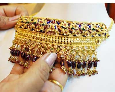 <p><b>A woman touches a gold necklace at a jewellery store in Allahabad</b> </p><p> Gold was firm on Thursday, underpinned by a soft dollar and expectations of further monetary easing in the United States, which traders said was likely to propel th