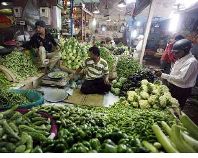 <p><b>A customer (R) buys vegetables at a market in Ahmedabad</b>