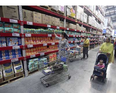<p><b>Customers shop at a Best Price Modern Wholesale store, a joint venture of Wal-Mart Stores and Bharti Enterprises, at Zirakpur in Punjab</b>