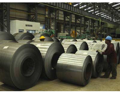<p><B>Labourers work inside a steel factory on the outskirts of Agartala</B> </p><p> India&#39;s economy probably grew an annual 8.7 per cent in the June quarter, its strongest pace since the December quarter of 2007, the median forecast of 21 econ