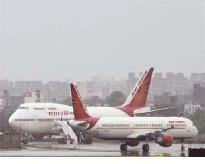 <p><b>Air India aircrafts stand on the tarmac during heavy rains at the Indira Gandhi International Airport in New Delhi</b>
