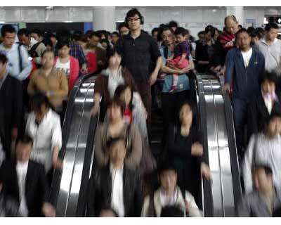 <p><b>A man holds his son (C) as they enter a subway station in People's Square, Shanghai</b></p><p>China's population grew to 1.34 billion by 2010, according to census data, which showed an ageing and more urban population that experts say i