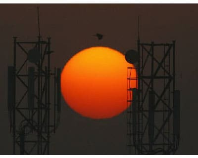 </p><b>Sun rises over the telecommunication towers in New Delhi</b></p><p>The CBI have arrested two executives, including the brother of former managing director of DB Realty, in a probe into a huge telecoms licensing scandal.</p><p>A spokeswoman for