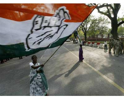 <p><b>A supporter waves a Congress party flag as she celebrates in front of the residence of Congress Party chief Sonia Gandhi in New Delhi</b> </p><p> Six of India's 28 states go to the polls in the next 12 months, narrowing the ruling Congres