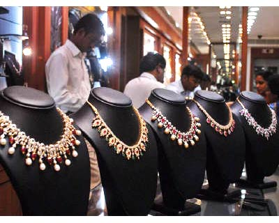<p><b>Salesmen at a jewellery shop attend to their customers in Hyderabad</b>