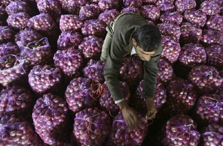 <p><b>A worker packs onion bags at a wholesale vegetable market in Chandigarh.</b> </p><p> The Reserve Bank of India (RBI) deputy governor K C Chakrabarty said on Thursday that inflation was always a concern, and a pause in rate hikes does not mean
