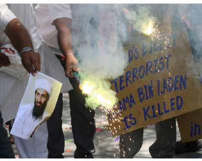 <p><b>People burn a photograph of Al Qaeda leader Osama bin Laden as they celebrate his death, in Ahmedabad</b></p><p>Osama bin Laden's demise is unlikely to lead to an influx of terrorist funds into Western banks but the threat of retaliation me