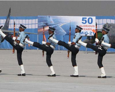 Air Force personnel perform with guns on 80th anniversary