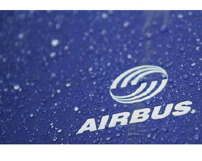 <p><b>Water drops are pictured on an umbrella with Airbus logo during a protest in front of the Airbus facility in the northern German town of Varel</b>