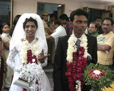 A couple in their marriage dress after casting theri vote