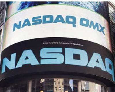 <b><p>The NASDAQ market seen in New York's Times Square February 8, 2010.</b> </p><p>Nasdaq OMX Group and Intercontinental Exchange responded late Sunday to NYSE Euronext's rejection of their joint proposed bid, reaffirming that their cash an