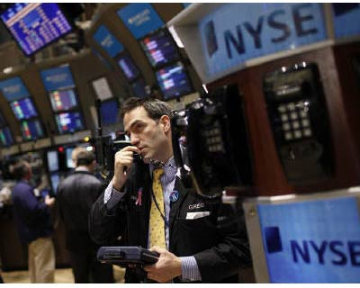 <p><b>Traders work on the floor of the New York Stock Exchange early in the trading session in New York.</b> </p><p> World stocks rallied in the first trading session of 2011 on Monday on stronger global manufacturing data, while oil closed at a 27