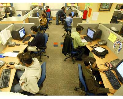 <p><b>Engineers attend to calls from abroad inside a call center in Gurgaon on the outskirts of New Delhi.</b> </p><p> The board of software services firm Patni Computer Services was planning to meet on Monday, a source said, where it is expected t