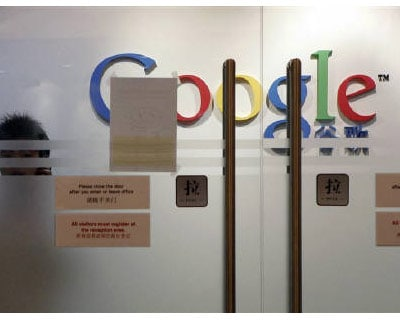 Google: A man places flowers on the Google logo at its China headquarters building in Beijing March 23, 2010. Google's decision to shutter its Chinese search website and redirect users to its Hong Kong-based search page has left the fate of its 6