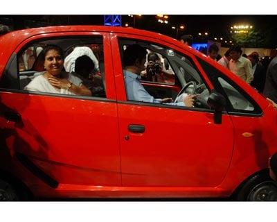 Guests inspecting the all new Nano on the night its launch in Mumbai on Monday