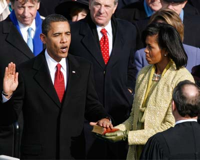 In a defining moment in US history, Barack Hussein Obama was today sworn in as the first black President in a country hungry for change after George W Bush's divisive wars in two distant lands and the economic troubles that shook the country and