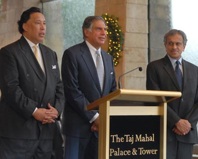 Indian Hotels CEO and Managing Director Raymond Bickson, Chairman Ratan Tata and Vice Chairman R K Krishna Kumar addressing the media in Mumbai on Sunday.