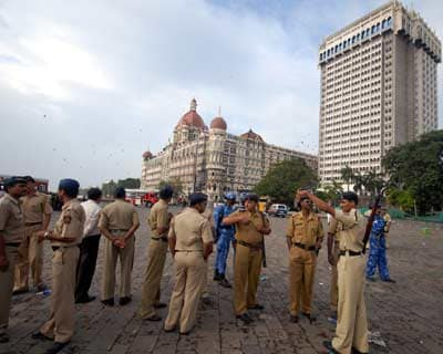 Security personnel breathe easy after the entire operation at the terror hit places was over. <br><br> <i>Picture by Divyakant Solanki</i>