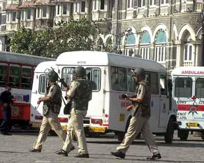 Security forces outside the Taj hotel