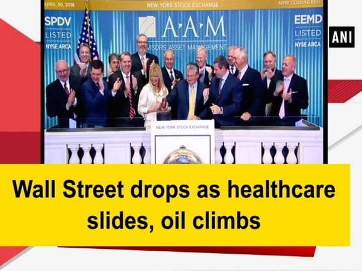 Wall Street drops as healthcare slides, oil climbs