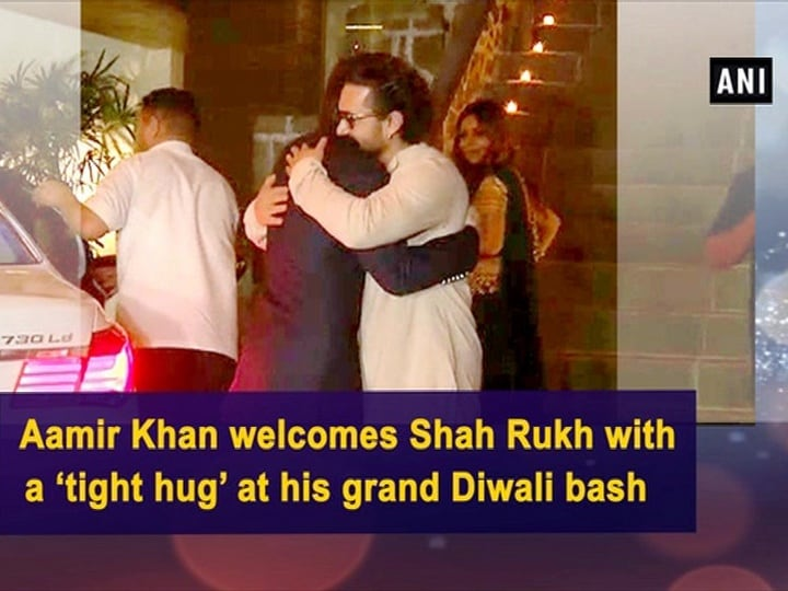 Aamir Khan welcomes Shah Rukh with a 'tight hug' at his grand Diwali bash