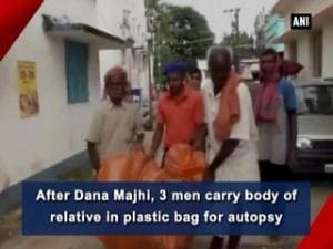 After Dana Majhi, 3 men carry body of relative in plastic bag for autopsy