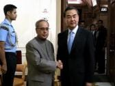 China Foreign Minister meets Pranab, calls for greater cooperation