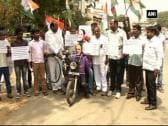 Congress party protests fuel price hike by Modi government