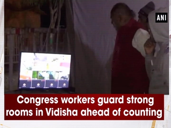 Congress workers guard strong rooms in Vidisha ahead of counting