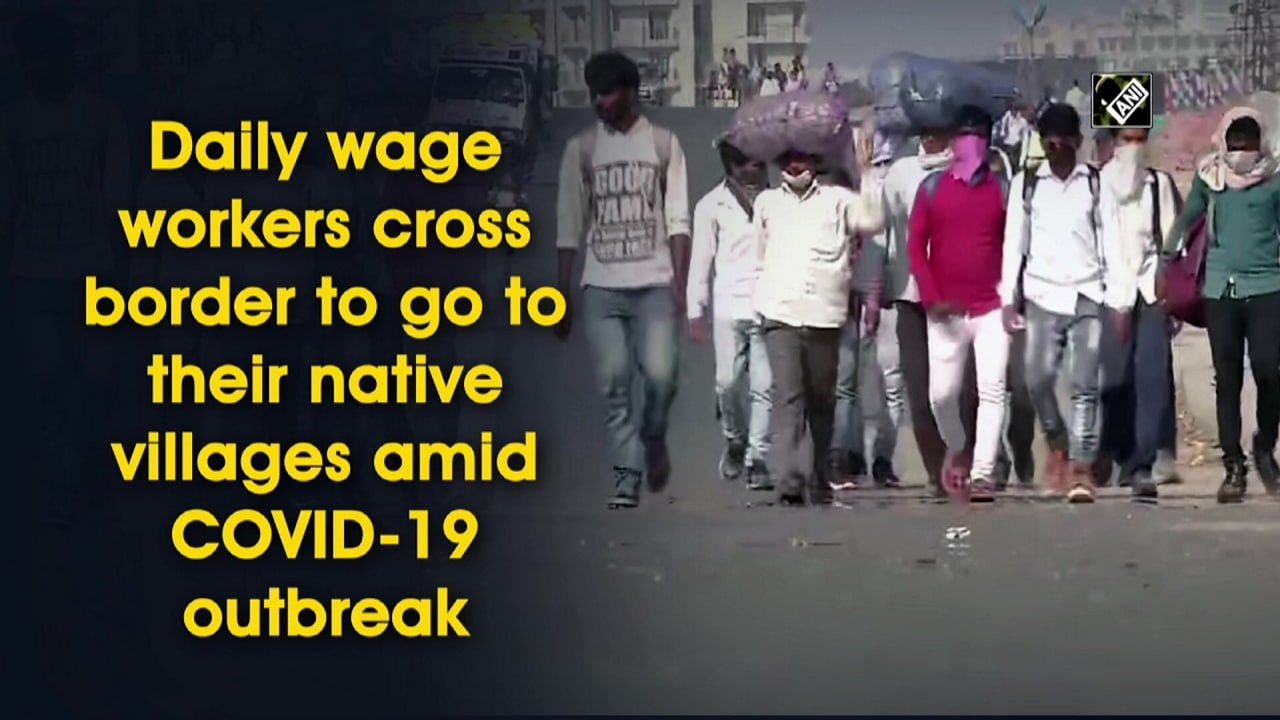 Daily wage workers cross border to go to their native villages amid COVID-19 outbreak