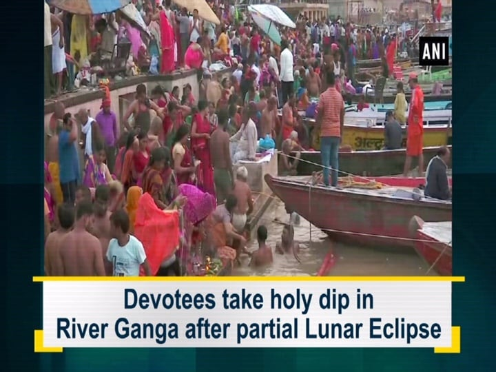 Devotees take holy dip in River Ganga after partial Lunar Eclipse