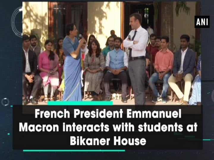 French President Emmanuel Macron interacts with students at Bikaner House