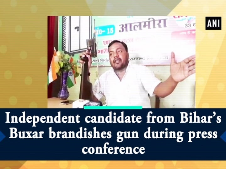 Independent candidate from Bihar's Buxar brandishes gun during press conference